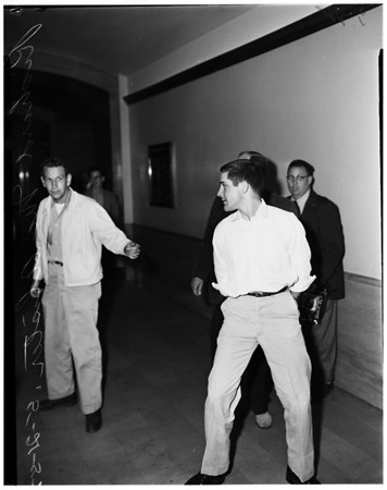 Attempted murder suspect ... City Hall, 1952.