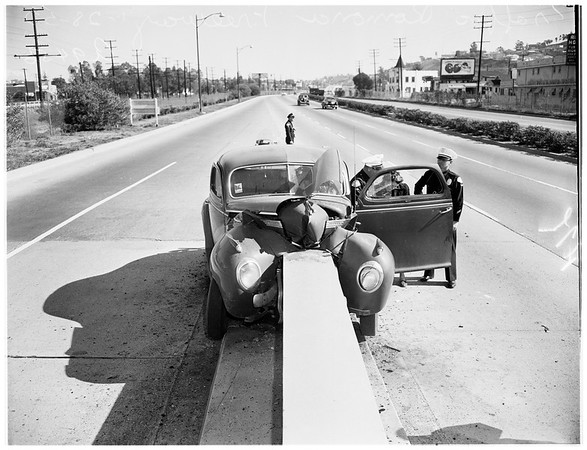 Auto accident ...auto crashes into concrete slab on Ramona Freeway (Freeway 10?), 1952