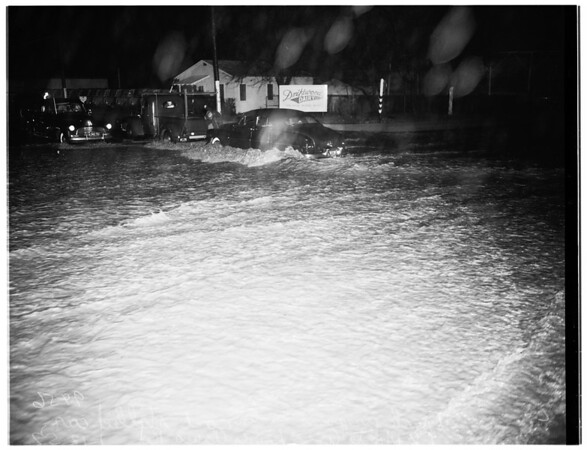 Flooded streets, rain, and high water, 1952