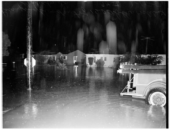 Monterey Park flooded ...pumping water out of 1200 Block on West Mabel Street, 1952