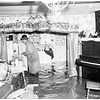 Flooded streets and houses at South Topana Canyon Boulevard and Topanga Lane, 1952