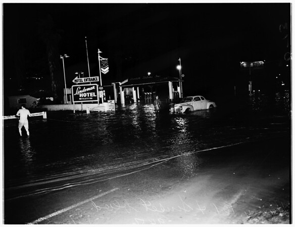 Water running into ocean at intersection of Highway 101 and Sunset Boulevard, 1952