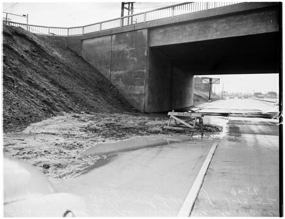 Mud slide under Santa Monica Boulevard bridge on Hollywood Freeway, near Western Avenue, 1952