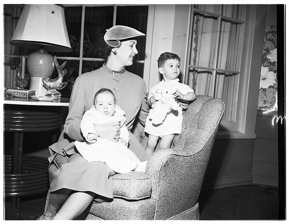 Resident of Paris visits her mother, Mrs. A. T. Jergens (not in picture), 1951