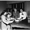 Junior auxiliary members cooking for girls' club of Assistance League party, 1951