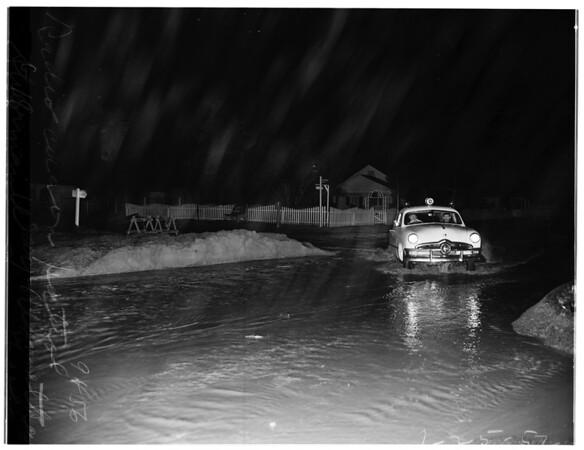 New rain and flood danger hit valley ...Reseda Area ...radio car on patrol at Sherman Way and Winnetka Avenune, 1952