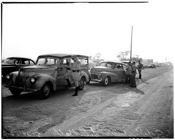 Traffic checks ... Washington Boulevard near Anaheim--Telegraph Road, 1952