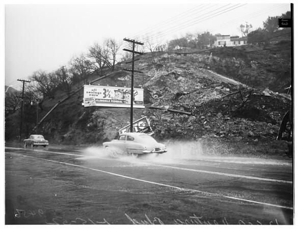 Landslide partially covers Ventura Boulevard at 12600 Block, Studio City ...large drainage pipe broken, 1952