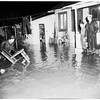 Flooded streets and houses at South Topana Canyon Boulevard and Topanga Lane, 1952