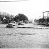 Floods at Burbank Boulevard and Tyrone Avenue...three feet of water and stalled cars, 1952