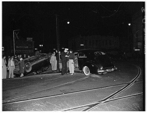 Accident ...auto versus auto ...Aliso Street and San Pedro Street .. one upside down ...no serious injuries ...General scene of accident, 1952