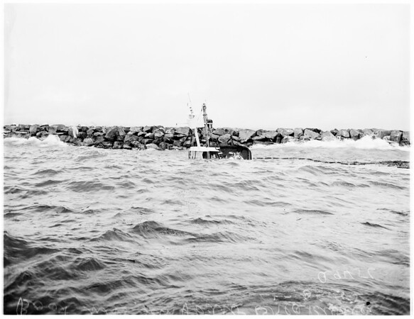 Fishing boat wrecked on San Pedro Harbor Breakwater...all aboard saved, 1952