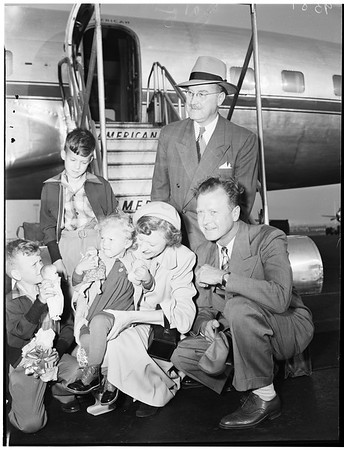 German baby arrives, Los Angeles International Airport, to be adopted by Craigs, 1952