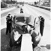 Auto accident ...auto crashes into concrete slab on Ramona Freeway (Freeway 10?), 1952
