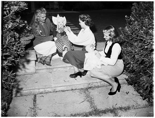 Making preparations for annual doll fair for Children's Hospital ...at the home of Mrs. Ridgway (not in picture), 355 South Rimpau Boulevard, 1951
