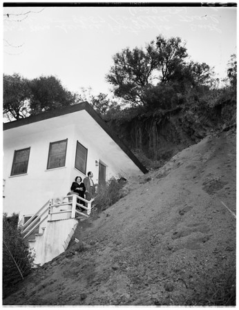 Cave in of house by earth slide...8057 Rothdell Trail, 1952