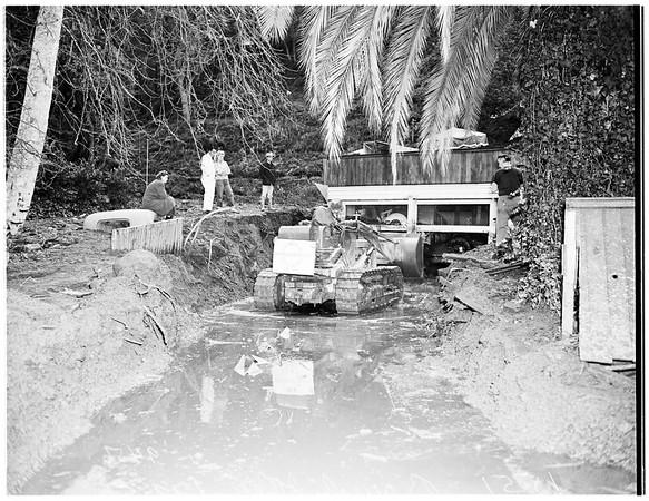 Flood damage repair at Benedict Canyon Drive ...damage at North Beverly Glen Boulevard, 1952