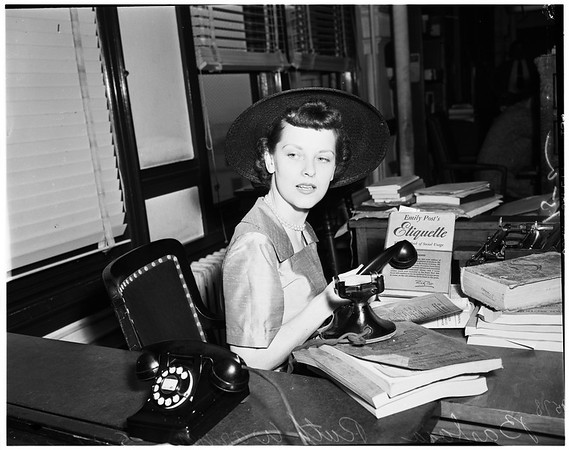 Files suit to change other wife's telephone listing, 1952.