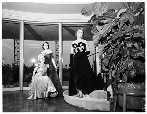 Modeling gowns to be worn at ruby ball, 1951