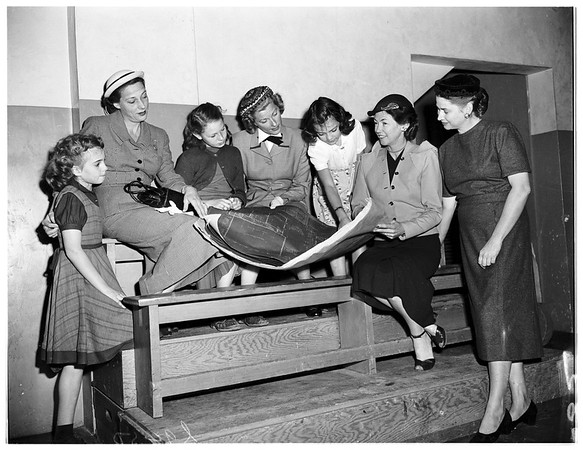 Junior League women and girls with plans for new building, 1951