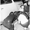 Auto accident at Santa Monica Boulevard and 10th Street...man falls from car and is run over by another, 1952