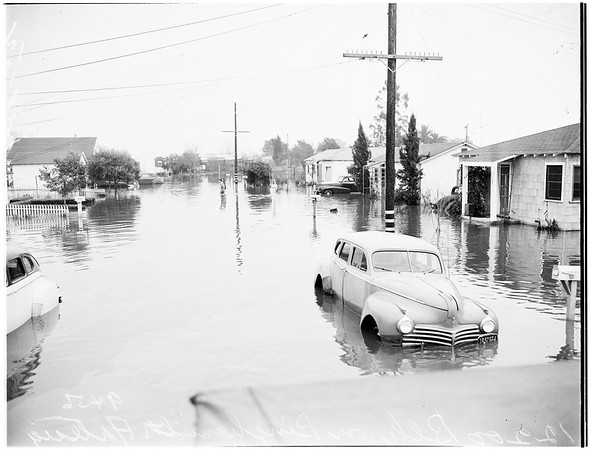 Artesia flood ...houses flooded and under water ...flood at Grammar School ...refugees in Methodist Church ...submerged cars ...Bingham Street scenes, 1952