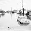 Artesia flood ...houses flooded and under water ...flood at Grammar School ...refugees in Methodist Church ...submerged cars ...Bingham Street scenes, 1952