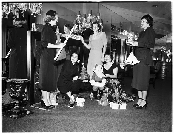 College Alumni of Assistance League girls plan Noel Damsant at Beverly Hills Hotel, 1951