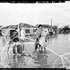 Los Nietos storm pictures ...Street two feet under water ...Flood did not invade houses ...East Verbeck Street, 1952