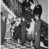 The Denis Alexanders give cocktail party at the home of her parents, the James Wendell Hunts, 1951