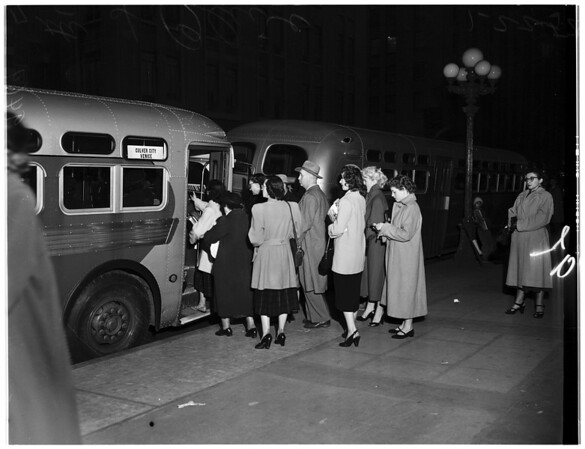 Crowds and street cars -- buses, 1952