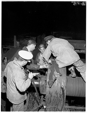 Man with hand caught in oil well drilling equipment, 1952