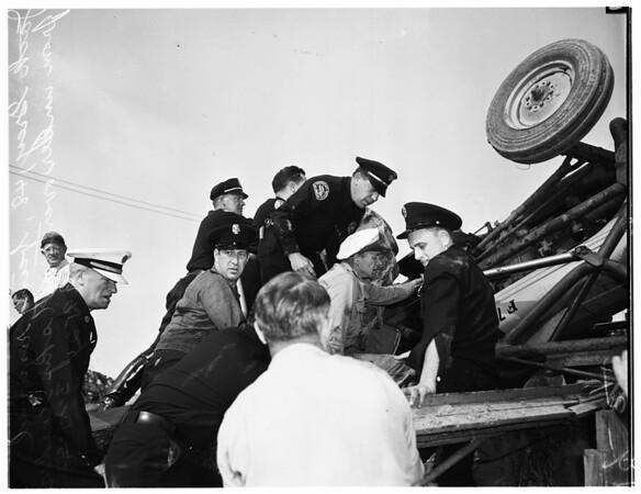 Man trapped under skip loader at 2217 Miramar Street, 1952
