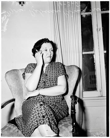 Poker raid (636 North Spaulding Avenue), nine women in poker game, 1952