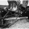 Man trapped under skip loader at 2217 Miramar Street, 1952
