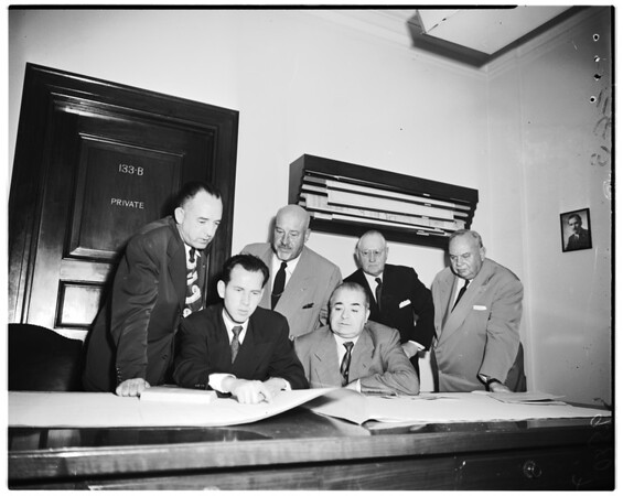 Hearing on junking of $469,000 of plans for police building, 1952