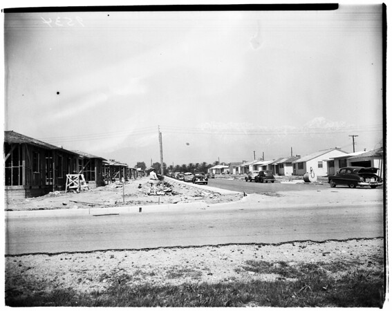 "Upland Picture layout... City Hall... Fire Department... Orange Grove and Orchard... Main Street... New Housing projects... Monument, ""Madonna of the Trail"", 1952"