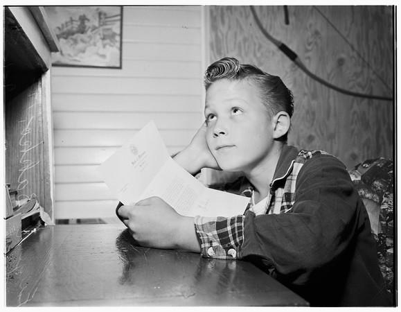 Boy letter writer, 1952