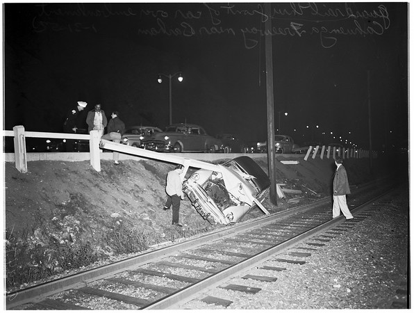 Car over embankment (Cahuenga Freeway near Barham Boulevard), 1952