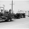 Accident at North Main Street and Vigness Street... Truck and trailer overturned, 1952