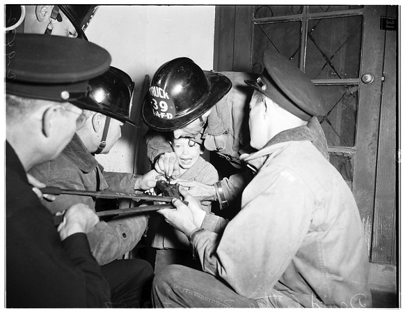 Boy's finger caught in can (Van Nuys), 1952