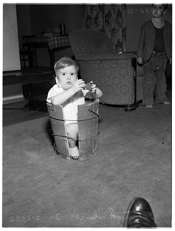 Boy stuck in ice cream freezer, 1952