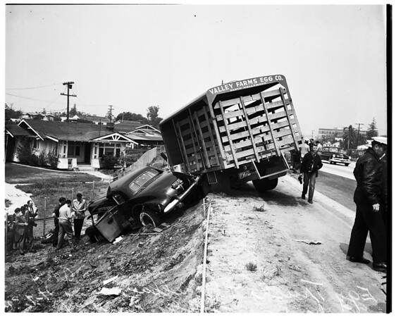 Auto versus truck ...Egg truck and cadillac over embankment, 1952