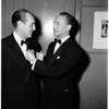 Los Angeles conductor receives award... Made officer of the French Academy for his work in introducing the music of France in the United States, 1952