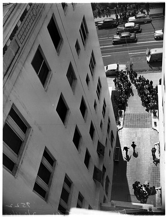 Murder and suicide... Mother kills self and child by leaping from window of Ansonia apartments, where she lived, 1952