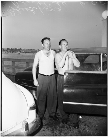 Two rescued from plane crash in ocean one mile off Seal Beach, 1952