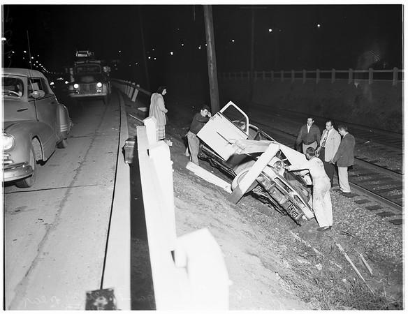Car over embankment (Cahuenga Freeway near Barham Boulevard), 1952