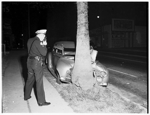 Auto into palm tree at 900 South Western Avenue, 1952
