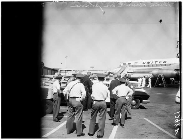 Man drunk -- went berserk on Los Angeles bound jet airliner (United DC-8), 1961