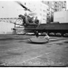 Helicopter delivering equipment on Gas Company roof, 1957
